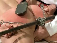 Brunette being painfully punished