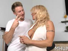 blonde cougar has a hot fuck on the kitchen counter