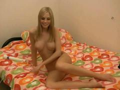 Blonde playing whit herself and toy