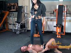 Abbie Cat tramples on slave in jeans then nude