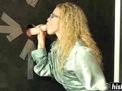 Blonde curly haired slut is sucking on that huge pecker inside a glory hole