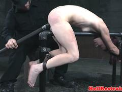 Restrained babe cums while being dominated