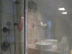 Smalltitted tranny showering while filmed