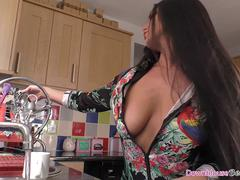 Hot brunette chick with natural tits cleaning the house