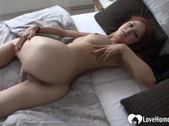 Redhead chick with nice tits pleasures herself