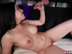 Busty masseuse jerks cock from underneath table