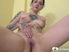 Tattooed maid loves rubbing her wet snatch